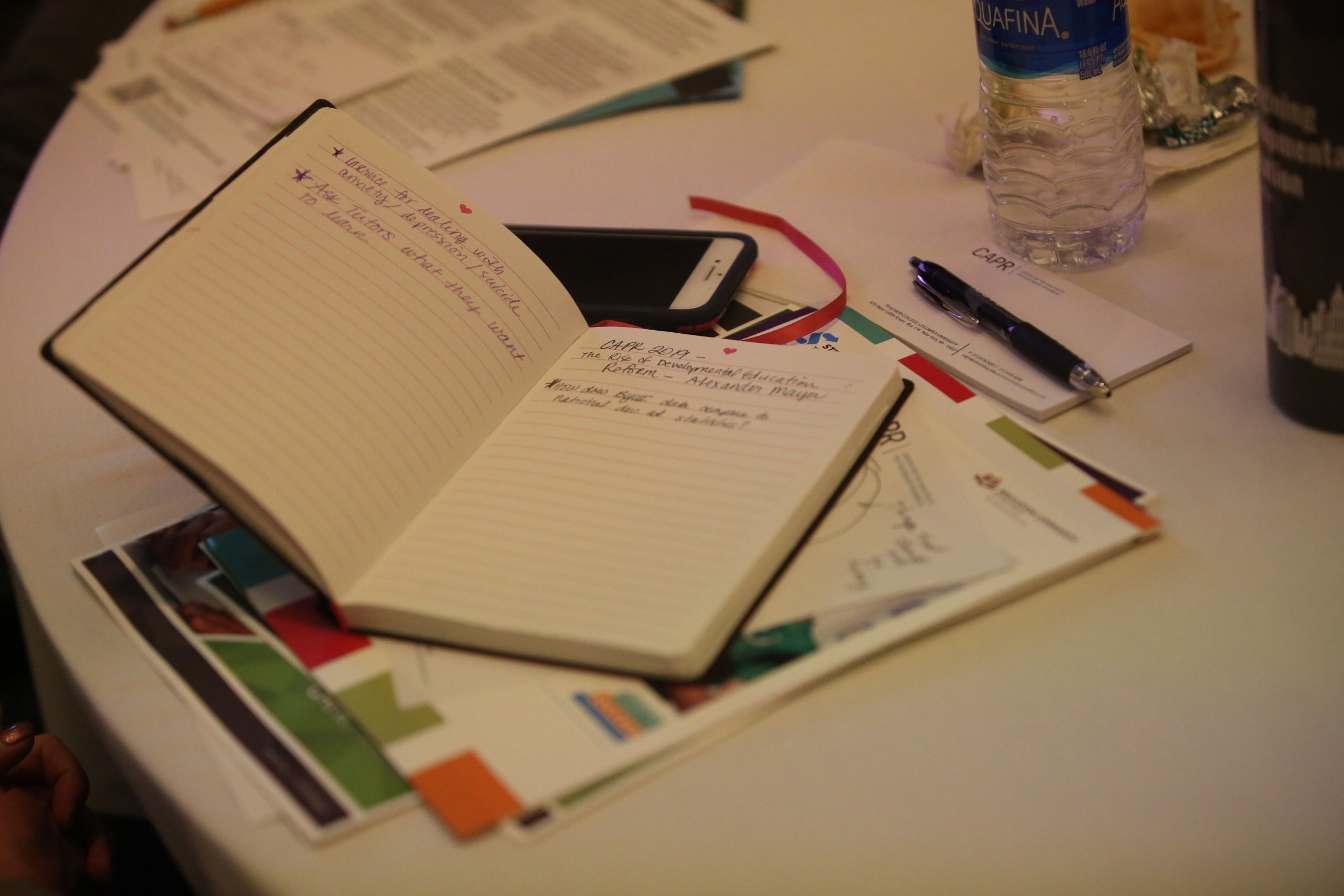 An open notebook on a table at the conference
