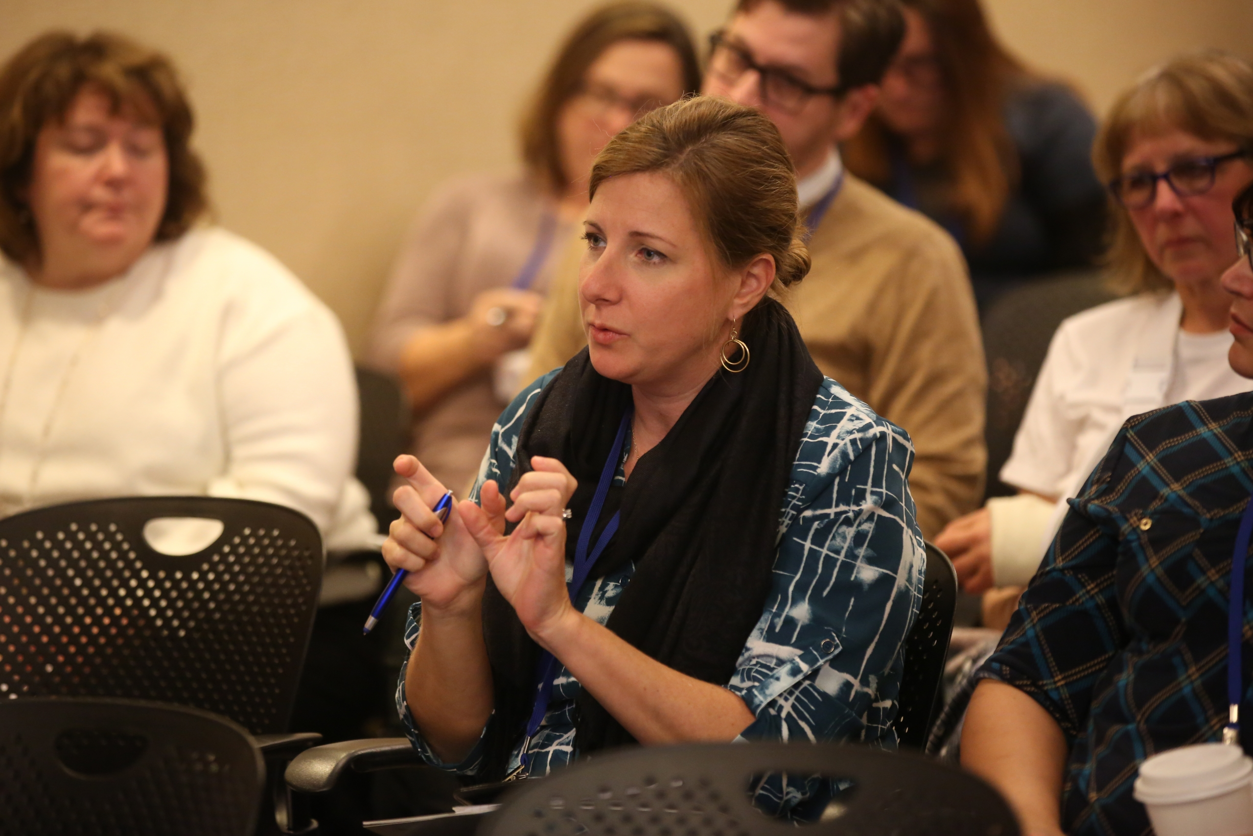 A woman asks a question during a breakout session