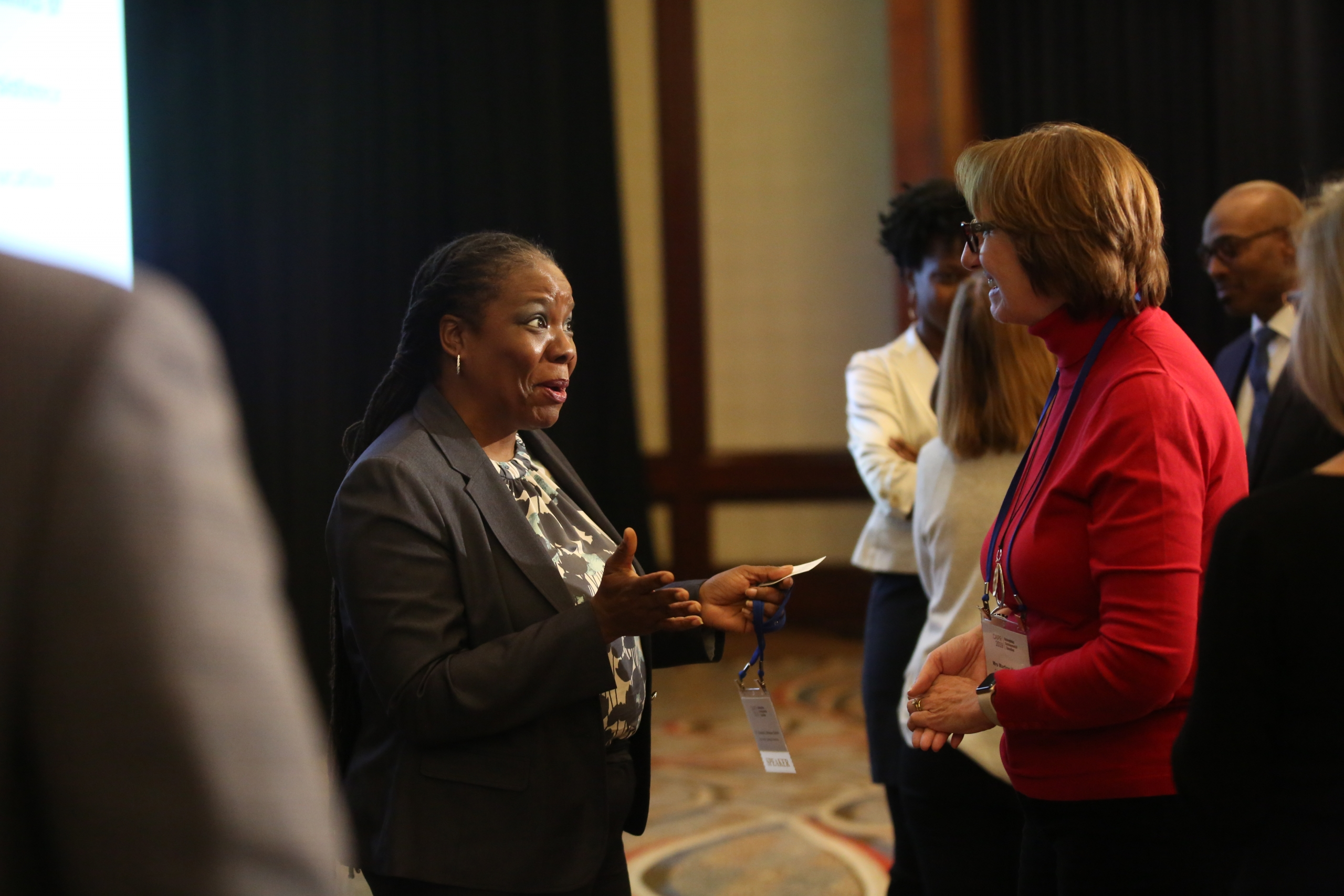 Yolanda Watson Spiva speaks to a conference attendee