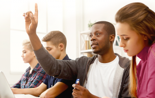 A student raises his hand in class